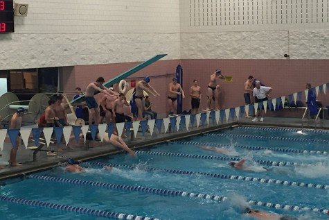 Sabre swimmers splash Warriors