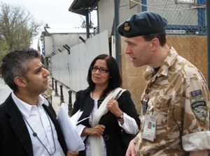 Sadiq Khan talking with a British soldier in the Royal Army.