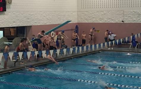 Sabre swimmers splash Warriors