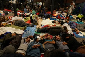 Syrian refugees resting in a Budapest railway station.