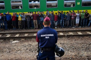 Syrian Refugees protest their detainment in a Budapest railway station.
