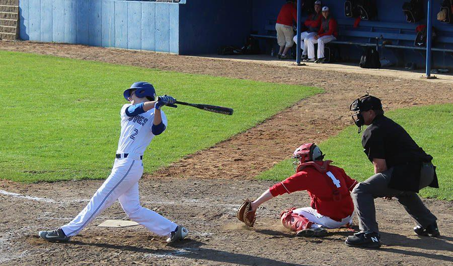#2 Carter Neuenschwander  Sr. CF takin' a swing