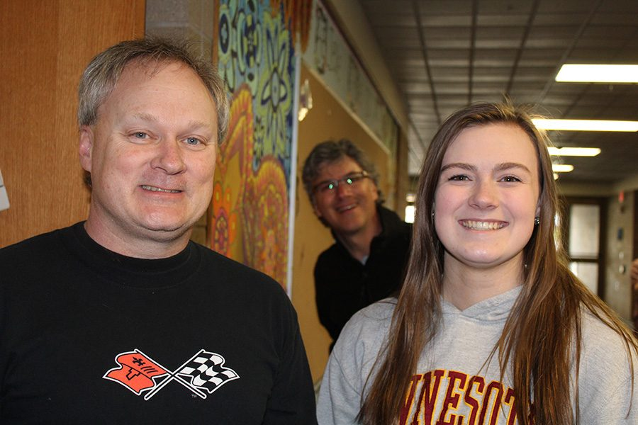 Katelyn and her dad pose while Mr. Kuhn slides in for a photobomb.