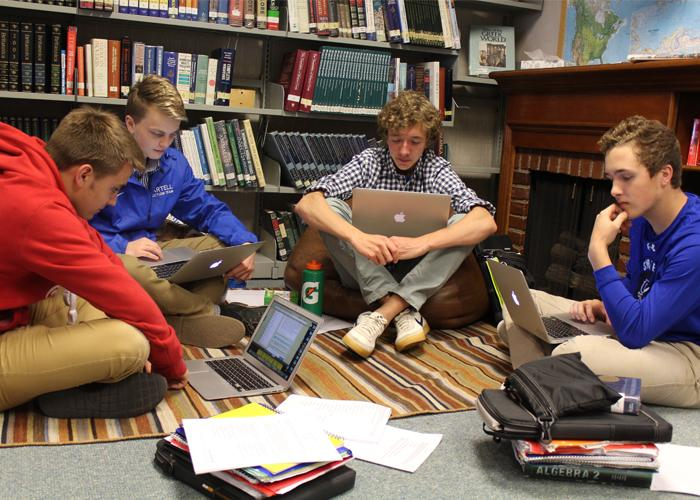 Sophomore guys in AP US History are studying intensely for the AP test.