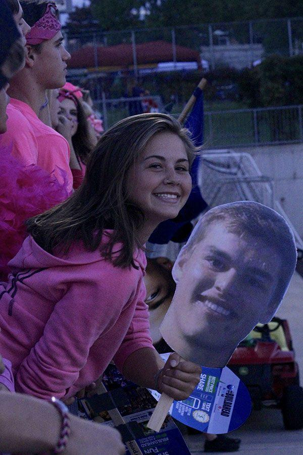 A fan with a cutout of a player's face