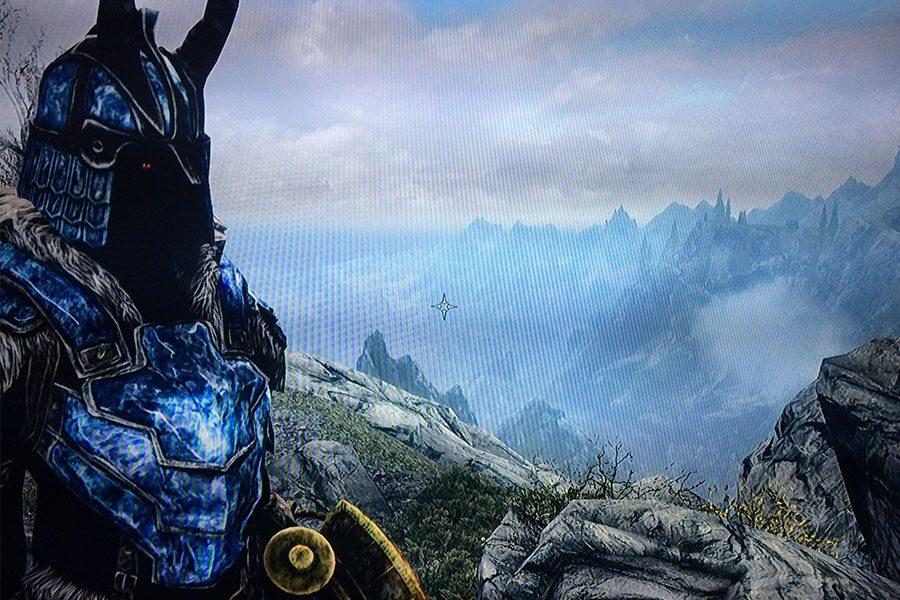 My character, Rellia, standing with the massive land of Skyrim in the background