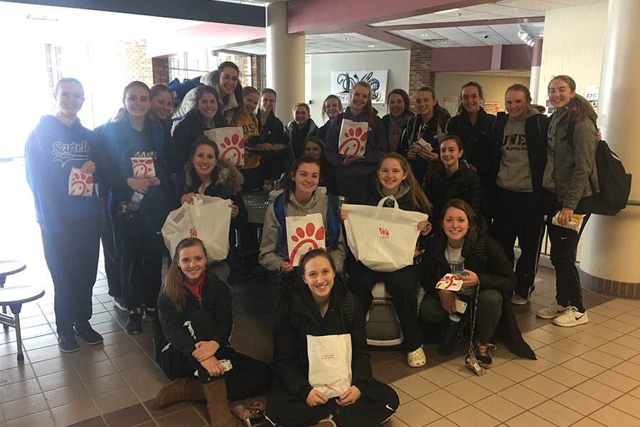 The+Sartell+Girl%27s+Basketball+team+enjoys+their+Chick-fil-A+after+a+morning+practice.