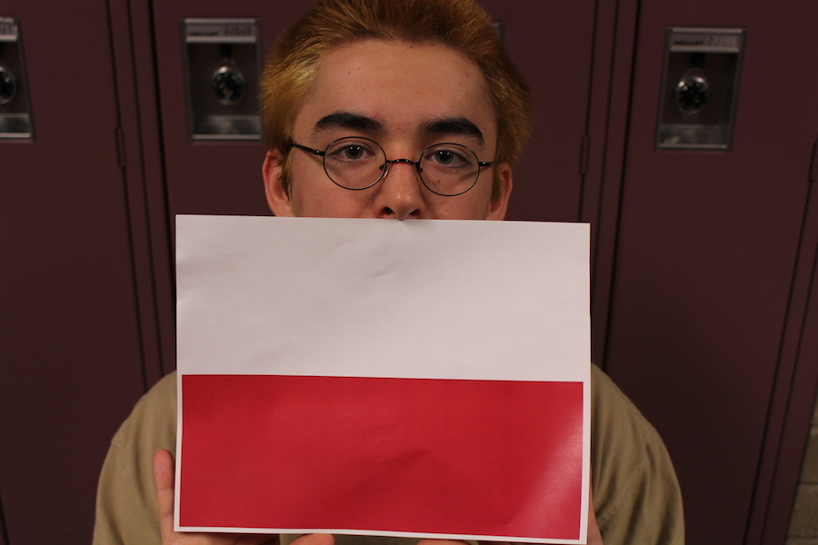Liam holds a copy of the flag of Poland.