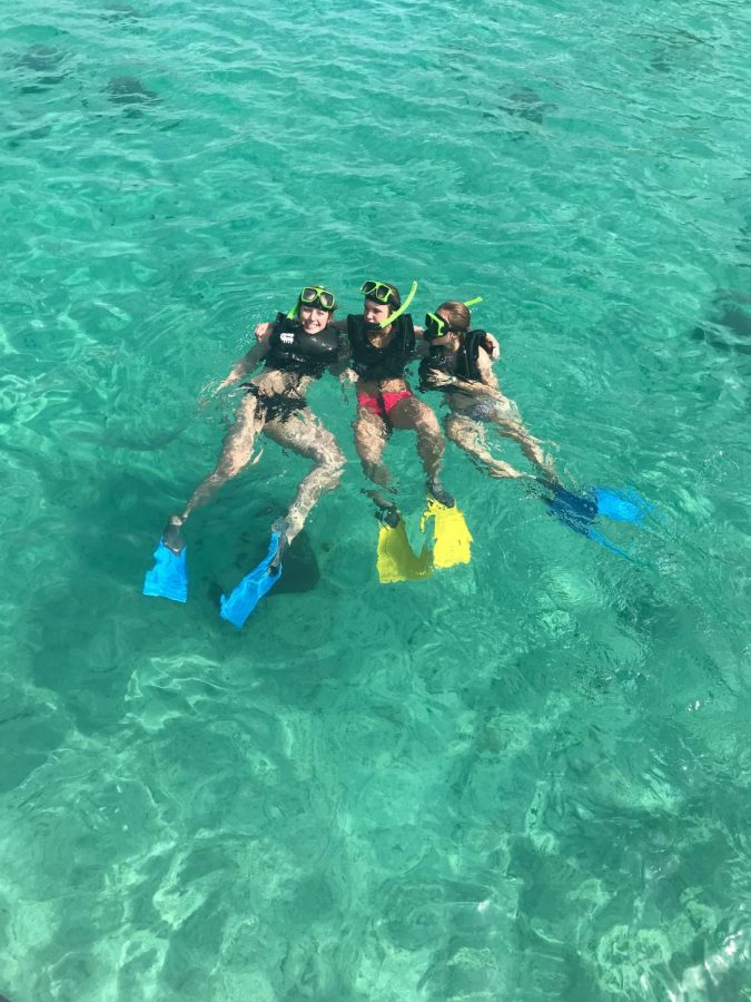Molly, Lexie, and Courtney in the clear waters of Aruba.