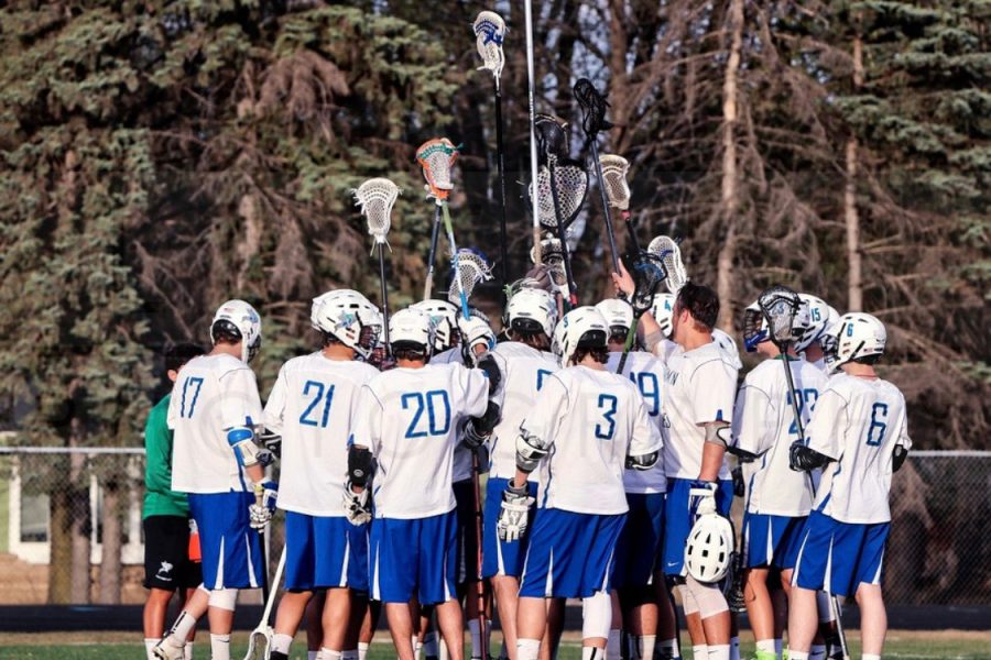 Boys lacrosse team celebrates a game well played.