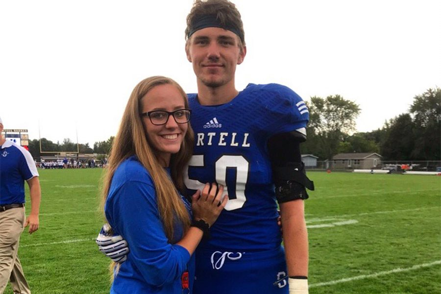 Rachael and Cymon smiling after Cymon's football game.