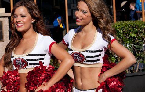 49ers cheerleader takes a knee