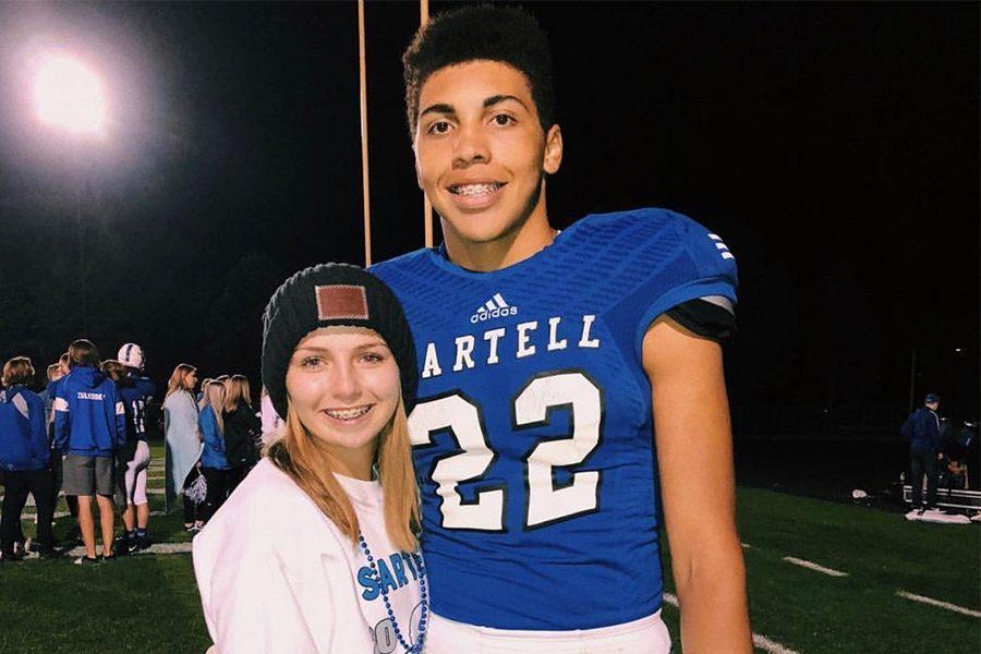 Jacob and Aniya smiling after Jacob's football game.