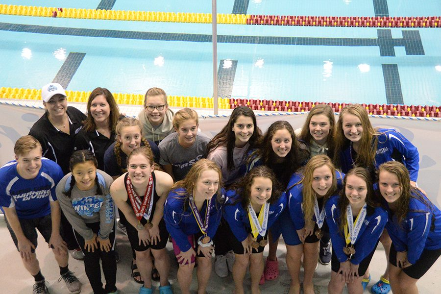 The+team+smiles+together+after+their+final+meet+at+the+University+of+Minnesota+pool.