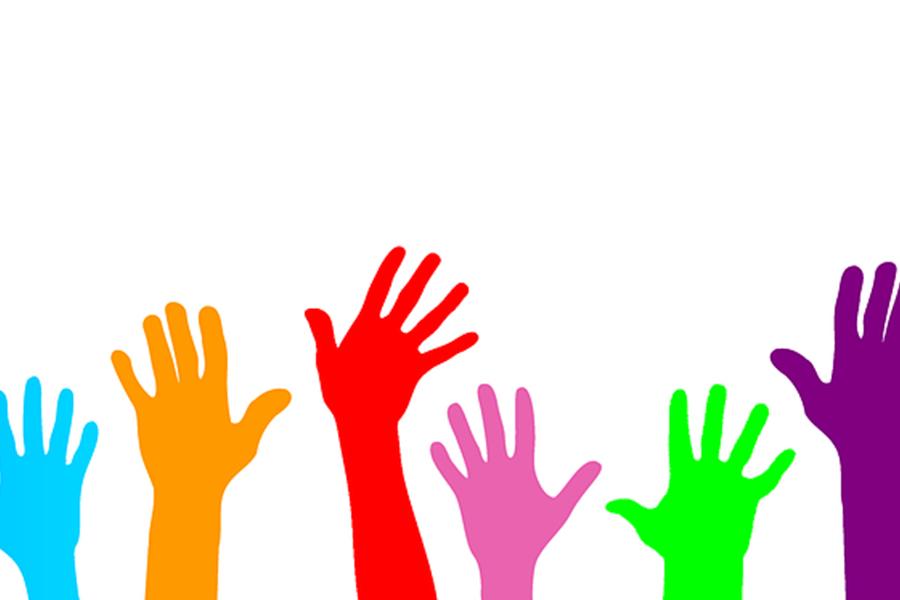 Hands raised for volunteering.