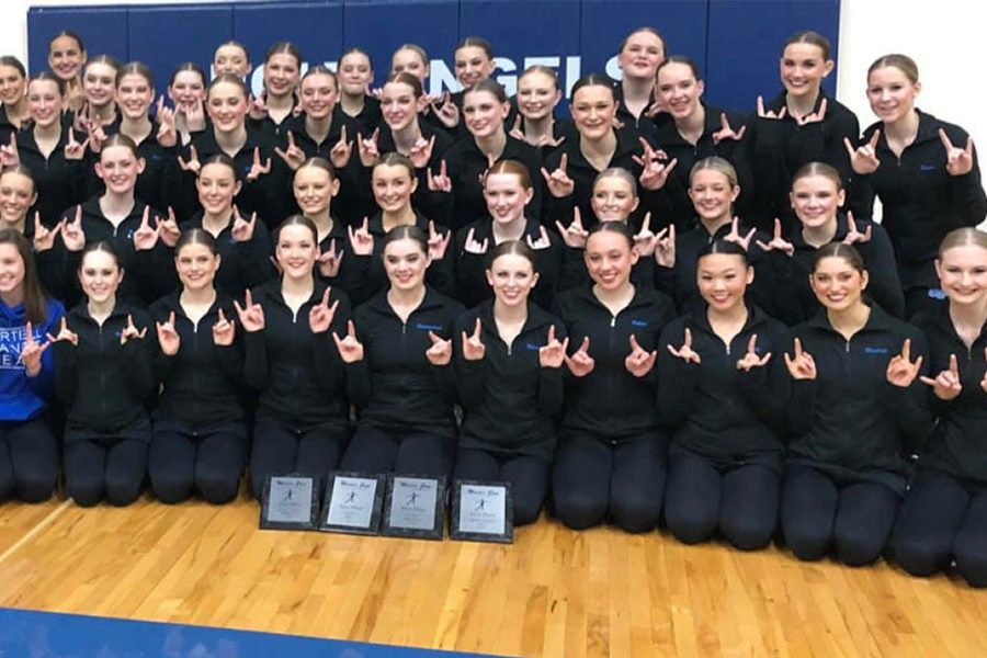 The+Sartell+Sabre+Dance+Team+celebrates+their+accomplishment+after+Academy+of+Holy+Angels+Invitational.