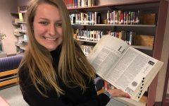 Journalist, Lauren Lindmeier, poses with a dictionary.