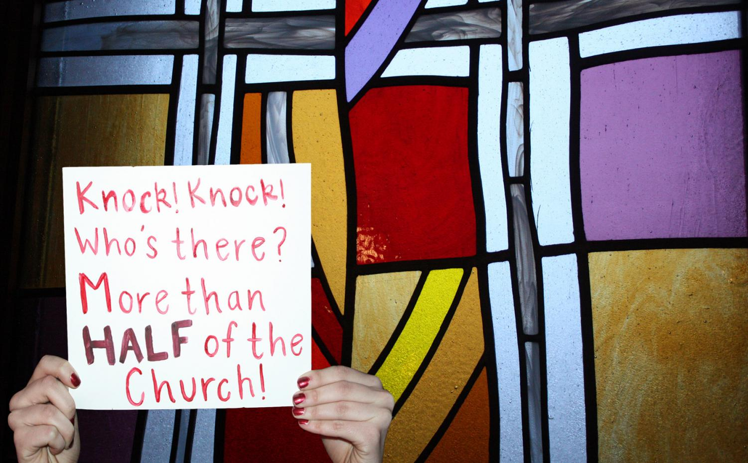 This poster was made by Lauren Lindmeier and the photo of the stained glass window is from Saint Francis Xavier Church in Sartell, the poster is similar to what the female protestors chanted outside of the Vatican.