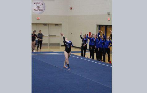 Sartell High School junior, Grace Wittmer George, performing her floor routine.