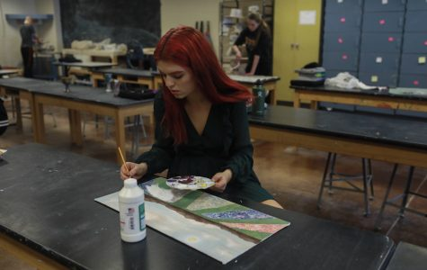 Greta Teich hard at work on another painting in the art room.