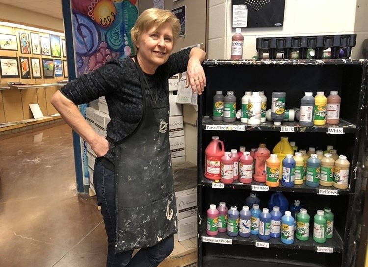 Mrs.Rollings+standing+next+to+one+of+her+many+collections+of+paints.+