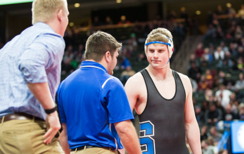 Senior Cole Fibranz before his final match, with coaches Josh Halicke and Cody Olson.