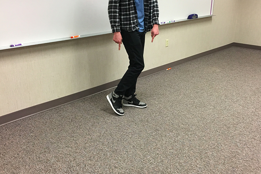 Ethan Plumier flexing his extra crispy Air Jordans in class.