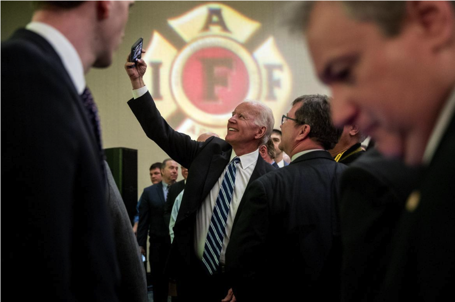 Joe Biden with firefighters right after his speech in March.