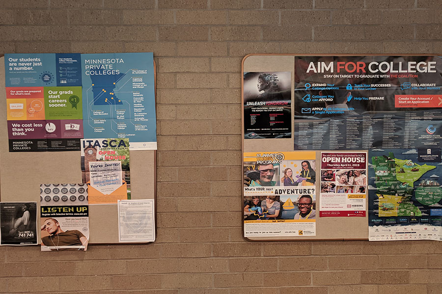 College flyers hang outside of the counseling office for students to legally get into the college of their dreams.