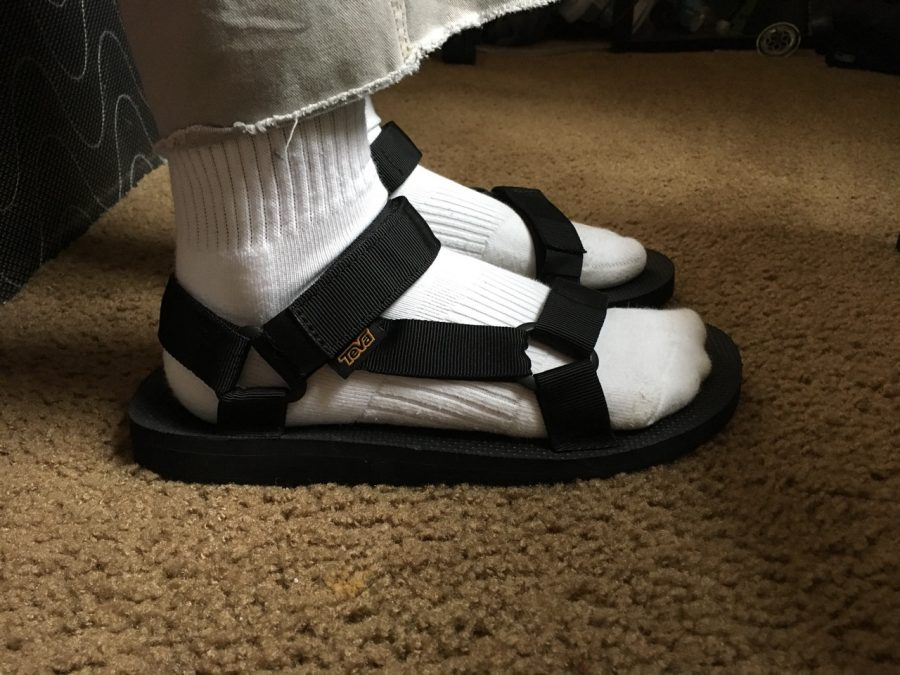 Kamaal Abdi's fly pair of sandals from Teva.