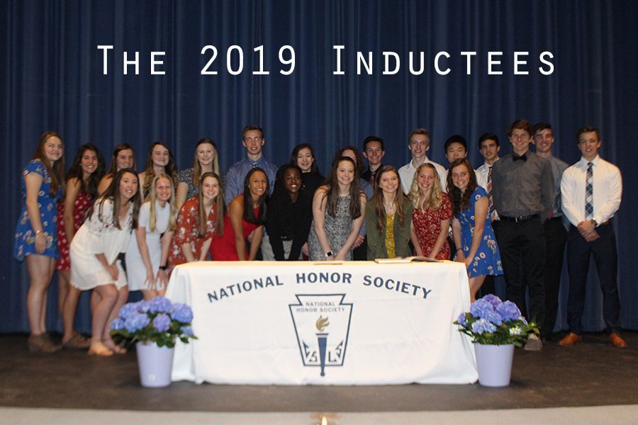 The+2019+inductees+smiled+for+a+picture+after+lighting+their+candles+and+signing+their+names+in+the+NHS+induction+book.