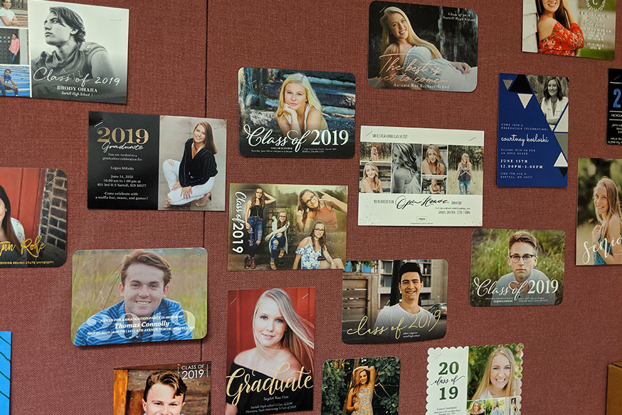 2019 seniors and their grad party invites hanging on Nelson's wall. Soon they will all be enjoying their new independence.