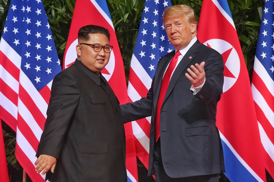 United States President Trump and North Korean Supreme Leader Kim Jong-un meeting for negotiations.
