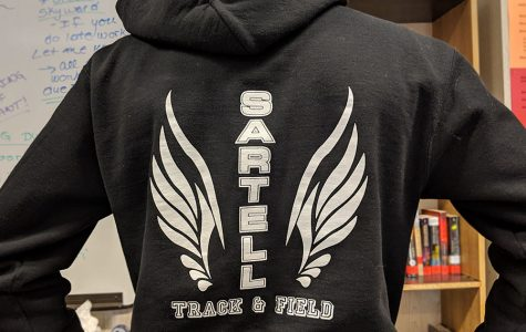 Sweatshirt of track athlete Ben Kiewel emblazoned with the Sartell Track and Field logo.