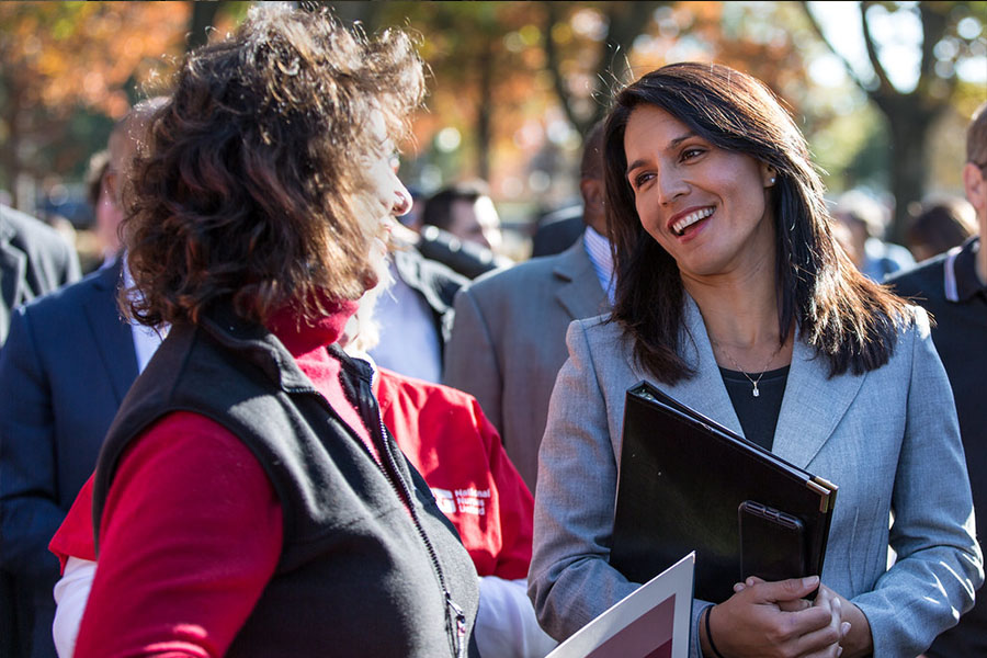 Tulsi Gabbard smiling and enjoying herself as she continues to be there for her supporters.