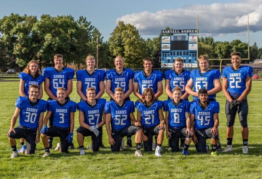 All+of+the+seniors+smile+as+their+picture+is+taken+to+start+of+their+last+high+school+football+season.