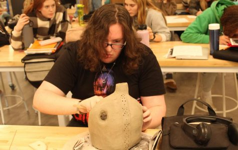 Professional artist, Melissa Gohman, helps mixed media class with stacking sculptures