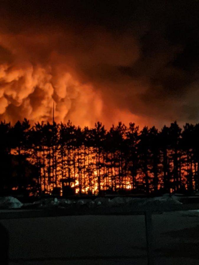 The+fire+blazes+near+a+treeline+in+Becker%2C+MN.