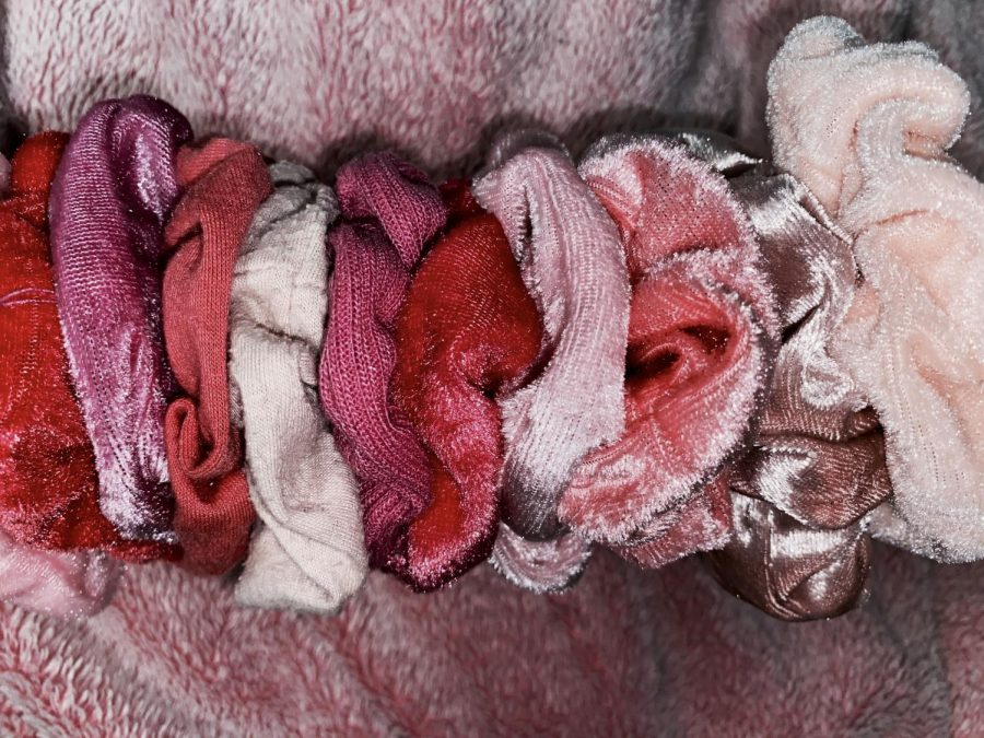 Pink is related to femininity, beauty, and softness. It is also the perfect color for a scrunchy.
