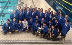 The boys' swimming team celebrates their victory and like being a cohesive team.