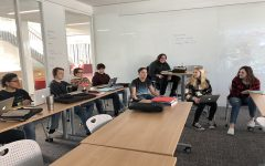 The journalism class had a discussion about the effects of phone tracking and social media.