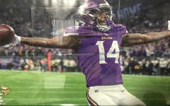 Stefon Diggs in the end zone after scoring a walk off touchdown against the New Orleans Saints on January 14th 2018.  This is a picture of the poster that hangs in my room.