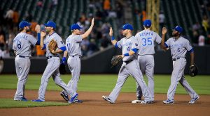 The Kansas City Royals gather to shake hands after a home win.