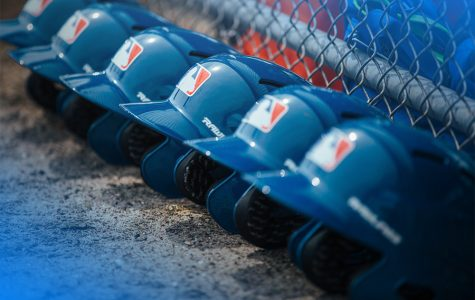 Image shows Helmets lined up against fence as MLB players await the season to re-open