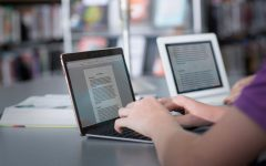 Students work at home distance learning while writing essays