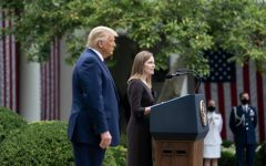 Donald Trump stands with his nominee for the supreme court; Amy Coney Barrett