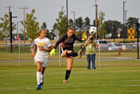 Chloe Swanson punting the ball during the regular season game against Sauk Rapids.
