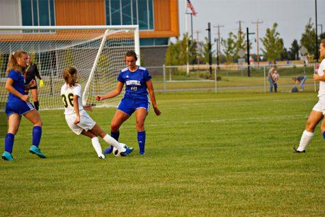 Elle Mahowald defending in regular season game against Sauk Rapids.