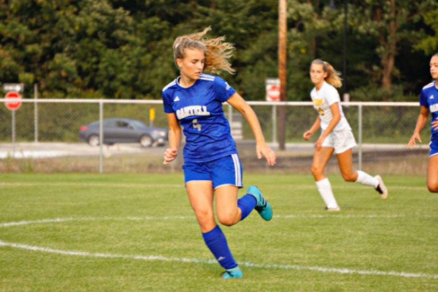 Hannah Hackenmueller running back on defense during the regular season game against Sauk Rapids.