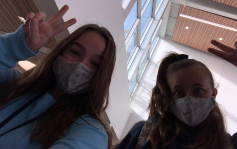 Annika and Leighton on the first day of school wearing matching masks.